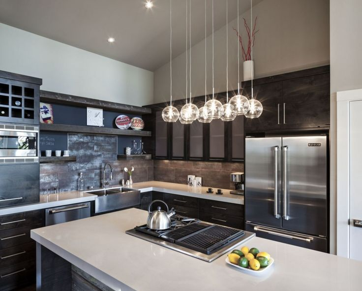 home lighting decor. this sleek kitchen features illuminating pendants as installed by lighting paradise see more home decor