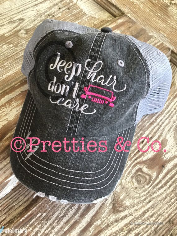 Embroidered 'Jeep Hair Don't Care' Truckers hat/cap with hot pink Jeep. Hat is Black Washed and has a distressed look. Back is grey mesh with adjustable Velcro.