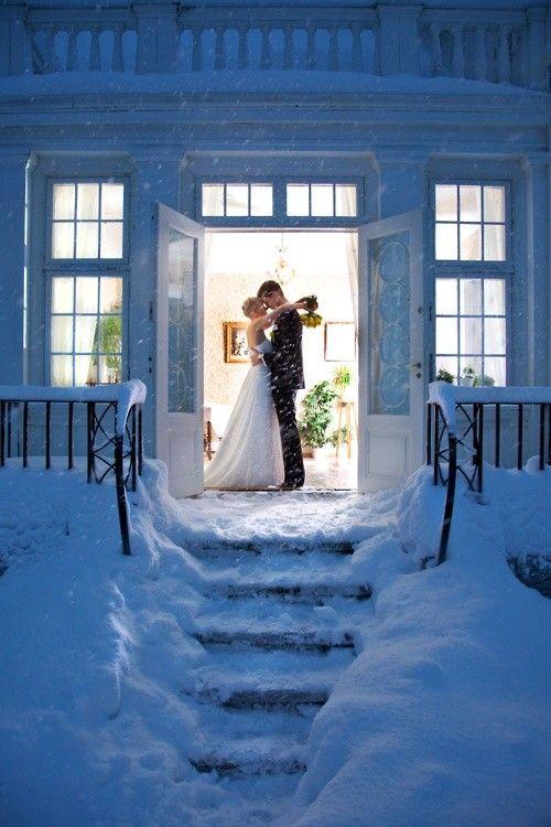 bride and groom - winter wedding, snow, kiss