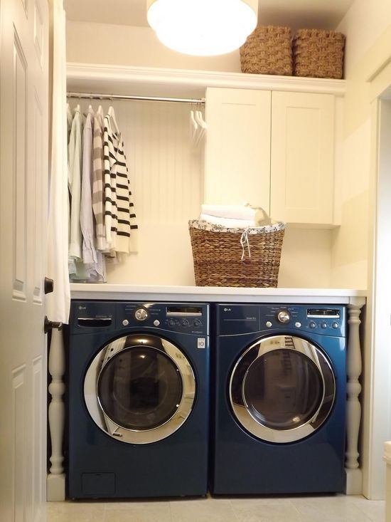 The perfect laundry room makeover for when I someday have my own house. It is so practical to put a counter over front-loading machines. A great place for folding and organizing. [blue washer and dryer!].