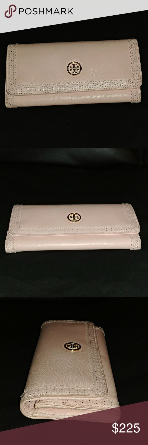 """Tory Buch Pink Shell Continental Envelop Wallet Rare! Sold Out everywhere! Tory Burch Robinson wallet is trimmed with a borrowed-from-the-boys spectator detail, creating a refined, tailored look.  Saffiano leather with tonal perforated and pinked trim.  Fold-over flap with magnetic snap closure.  Signature Tory Burch double-""""T"""" logo.  Inside, two open compartments, one zip compartment, three bill slots, and 10 card slots.  3 1/2""""H x 7 1/2""""W x 1 1/4""""D.  No tags, no box/bag  Imported of…"""