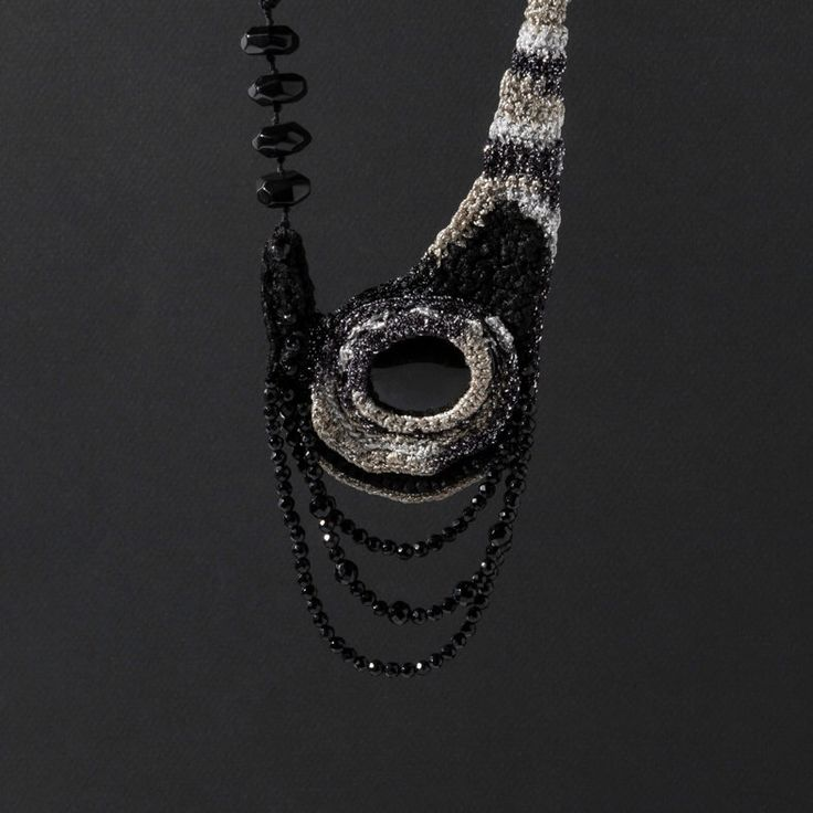 Long Crocheted Necklace in  Black, Silver, Golden /Free Form Crochet Necklace Pendant by natartg on Etsy https://www.etsy.com/au/listing/471554116/long-crocheted-necklace-in-black-silver