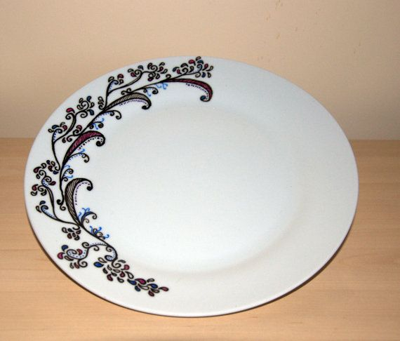Dinner plate hand decorated with stylized swirls by Extemporise, £11.00