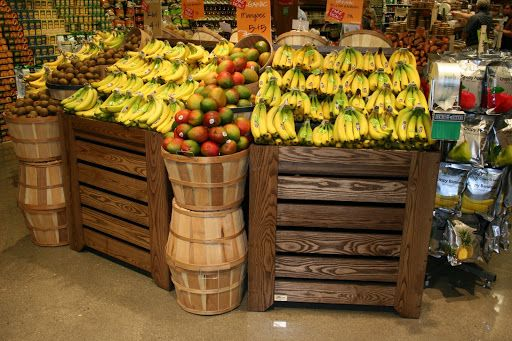 Grocery Store Produce Displays | Orchard Bin Banana displays with baskets merchandising various fruits