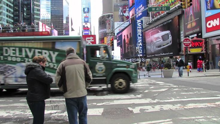 "A walk through Times Square in NYC. Fun to watch while reading ""A Cricket in TImes Square""."