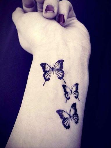 butterfly wrist tattoos.