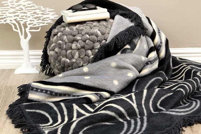 New Sesli Lily frill blanket in a modern design showcasing shades of black and grey