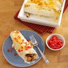 Makeover Sour Cream Chicken Enchiladas Recipe -My husband knows he's in for a treat when I begin rolling the enchiladas. This is his favorite dish, and the makeover version is yummy! We think it's a home run. —Rynnetta Garner, Dallas, Texas