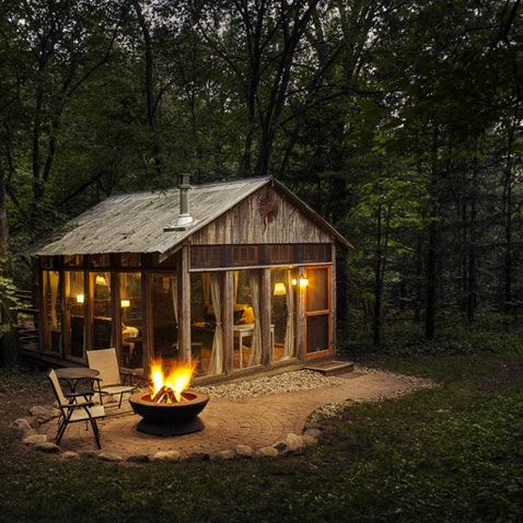 mini windowed cabin with outdoor patio and fire pit
