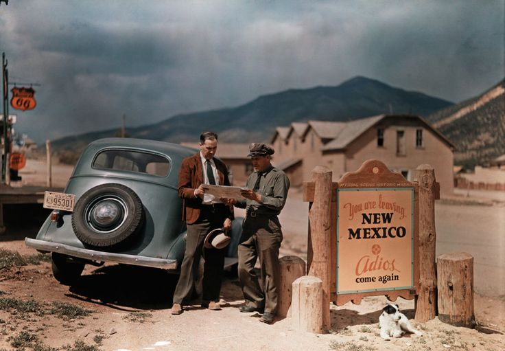 A tourist stops to get directions from a cop in Questa, New Mexico, 1926.Photograph by Luis Marden, National Geographic