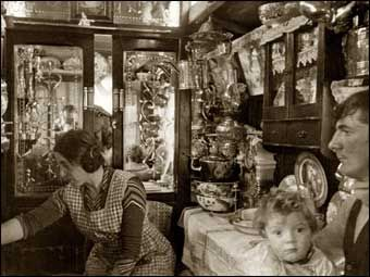 Edward and Famie Cooper in their vardo 1938. In Gypsy culture the inside of the caravan is very clean and well organized. A Gypsy family might not have much in the way of possessions but the caravan is treated with great pride and love as it is the refuge from both bad weather and the storms of humankind.