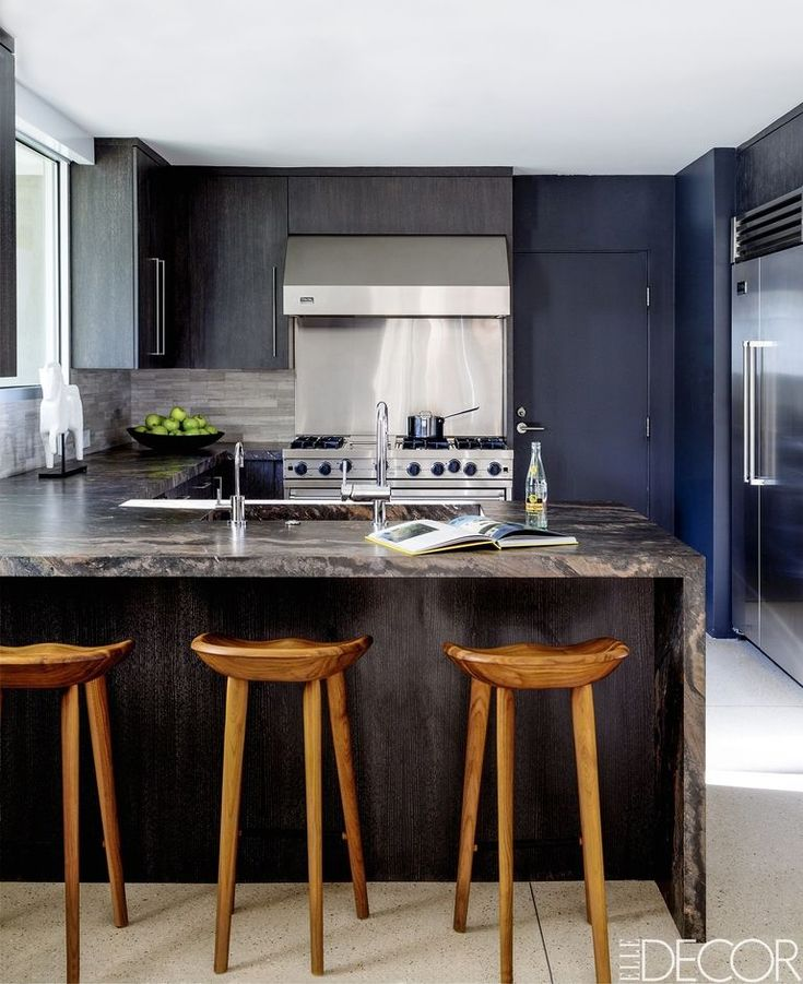 minimalist kitchen design with black cabinets and bar chairs