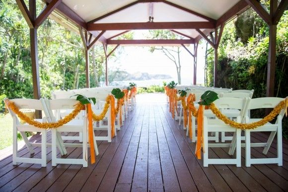 Garlands of fragrant flowers line the wedding ceremony aisle.