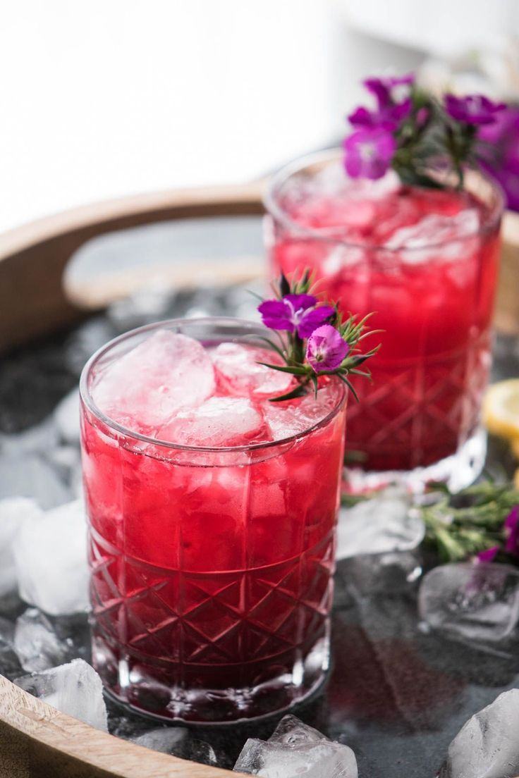 A little sweet and a little floral with underlying warm vanilla tones are the flavors that come together in this Hibiscus Bourbon Cocktail. Perfect for summer afternoons or to warm up in the winter when you're dreaming of warmer days, with just a touch of tropical flavor. #cocktailrecipes