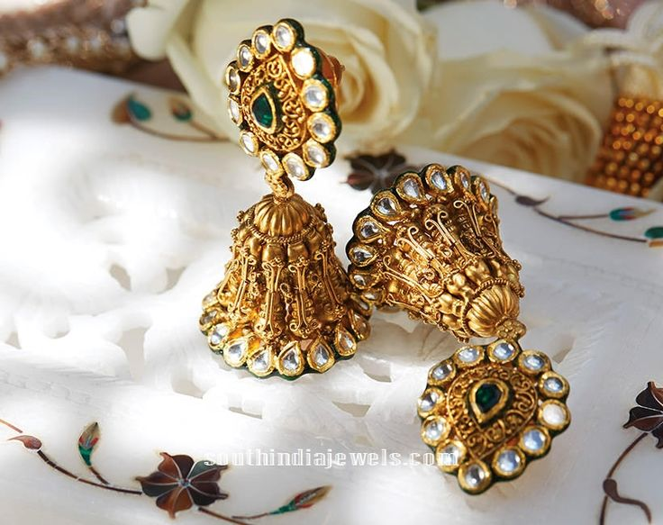 22k gold jhumka embellished with kundan stones from Tanishq. For inquiries please contact 1800-108-1100.
