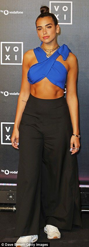Wowza: The songstress, who has just returned from an Italian getaway with her beau Paul Klein from US band LANY, flaunted her bronzed physique in the skimpy top and high-waisted wide-leg black trousers