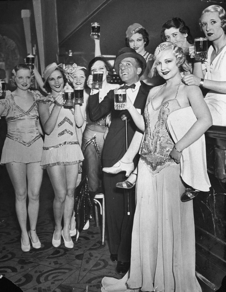 """Bandleader Ted Lewis with his """"Broadway Beauties"""" as they toast the repeal of Prohibition at the Hollywood Club."""