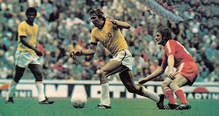 6th July 1974. Brazilian full back Marinho Chagas going away from Poland's Andrzej Szarmach during the Third & Fourth Place Playoff match.