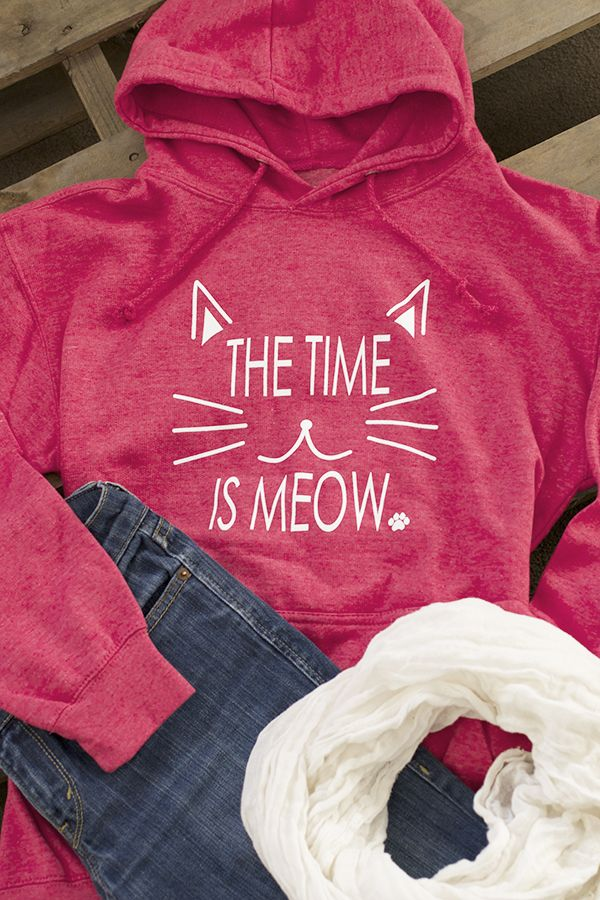 Our heathered hooded sweatshirt isn't only inspirational, it's adorable! Complete with a drawstring hood and cozy front pocket, the time to wear this hoodie is always right meow!
