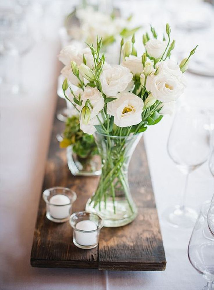 Add a few flowers from the garden and candles in glass containers (Source - laurenk.co.za)