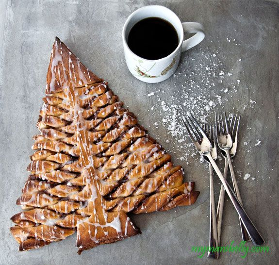 Cinnamon Roll Christmas Tree. No step-by-step images, but a pretty good description of how to make this tree out of homemade cinnamon rolls.