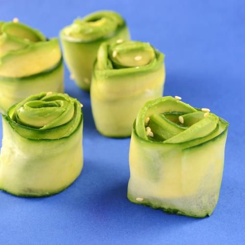 """Cucumber and Avocado """"Roses""""   The crunch of the cucumber lends an exciting hand to the creamy avocado in this quick snack, which would also work beautifully as an appetizer.   CookingLight"""