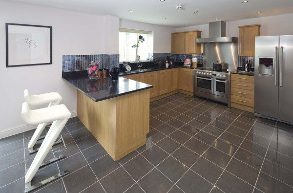 Taylor Wimpey - Typical Interior 2 Example of dark grey titles on floor