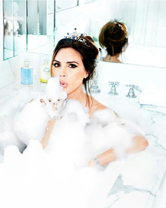 Victoria Beckham in the bathtub bubbles with tiara