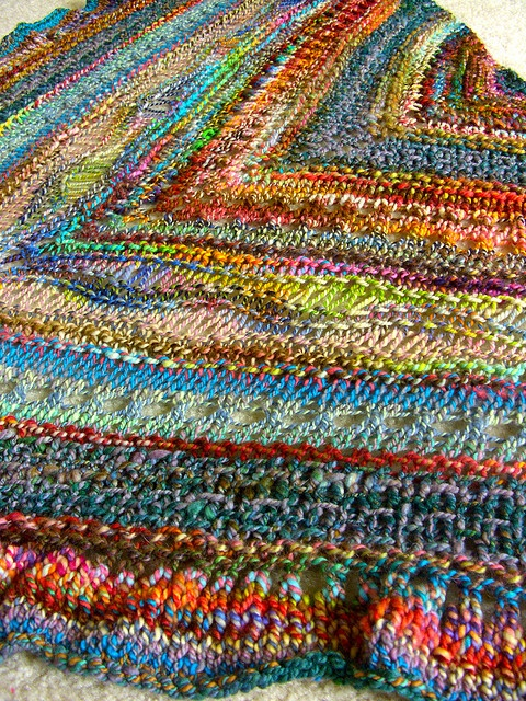 Gorgeous shawl knit from handspun yarn! I knit this pattern and it was really fun, but I didn't use handspun like this.  May need to try this again!