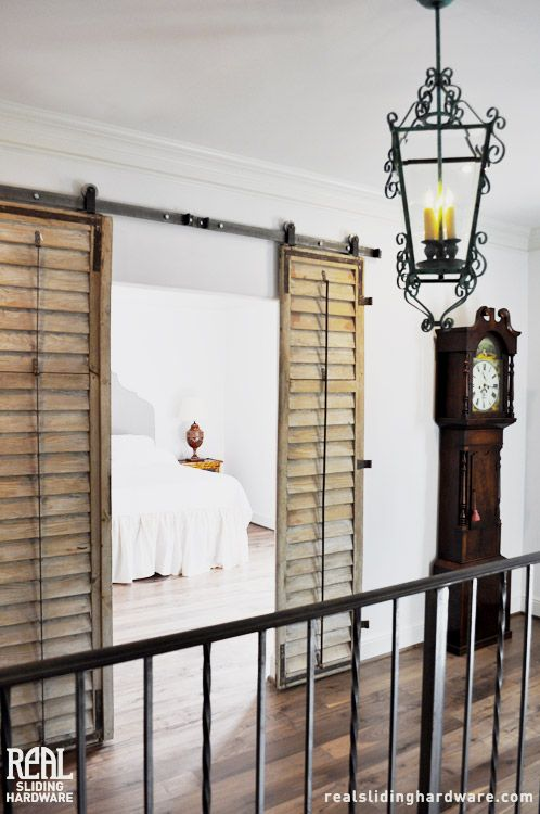 These shutters which were reclaimed from an 18th century for French door barn door