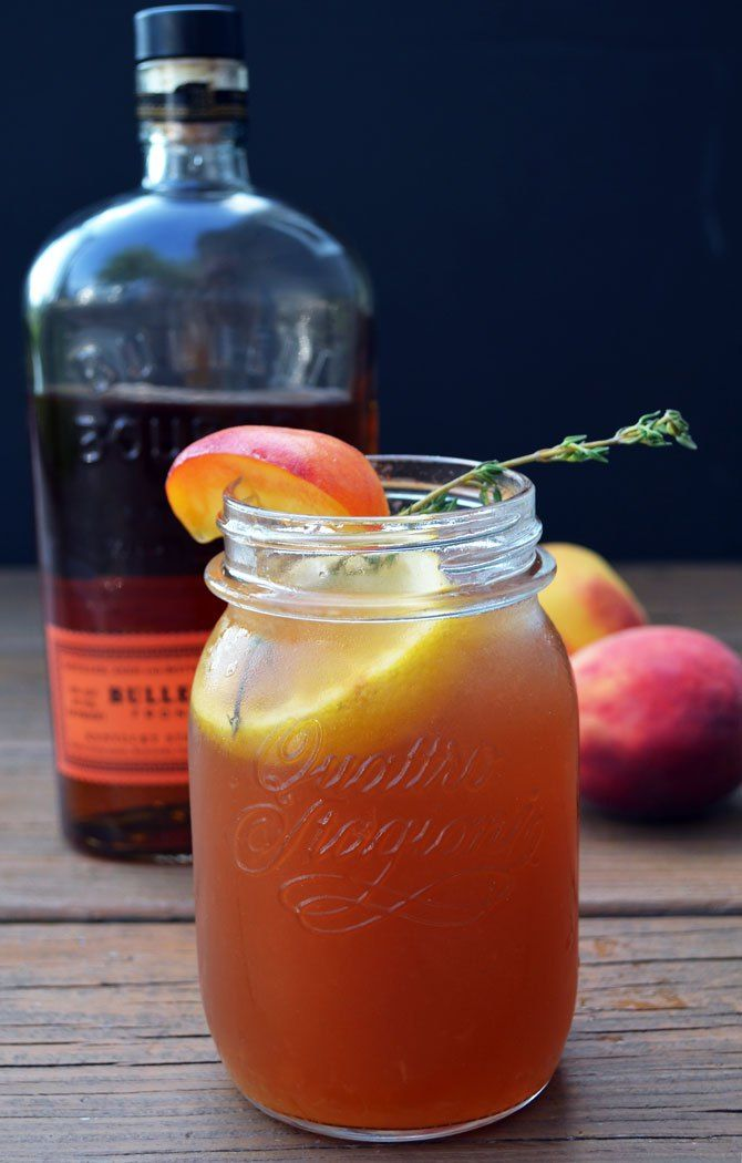 Bourbon Peach Sweet Tea 2 ounces bourbon 2 ounces peach preserves 1 ounce fresh lemon juice Dash of Aperol Sweet tea, to top Sprig of thyme, to garnish Lemon round, to garnish