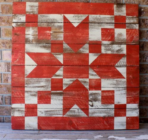"""A 33"""" x 33"""" Bear Paw Barn Quilt in a distressed cream and sunset color, finished for use outdoors and indoors too."""