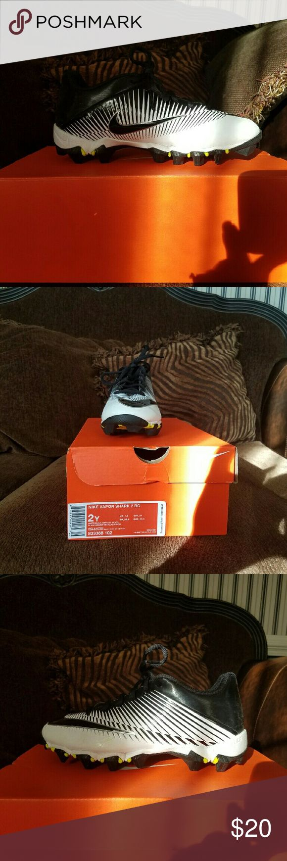 Boys Youth Size 2 Nike Cleats Black, white, and yellow.  Only worn twice and decided not to play football. Nike Shoes