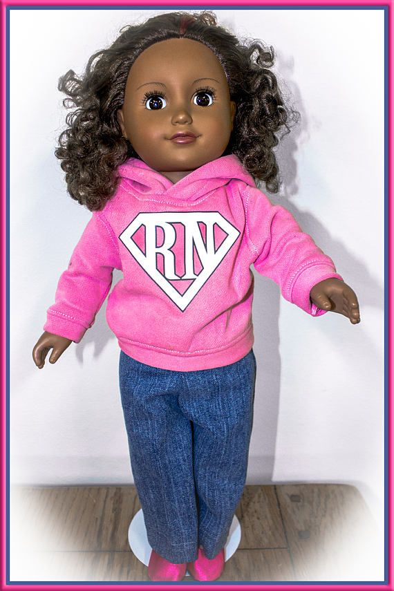 "This custom hoodie fits your child's 18 inch doll just like American Girl Doll Clothing. This outfit comes with custom logo work on the little 18"" doll Hoodies and the sweatshirts are available to be purchased with sweatpants, denim jeans, or shorts (your choice). Then you can even add a pair of shoes or boots to complete the outfit for either your girl or boy doll! Boy doll clothes aren't easy to find, and these hoodies can be decorated with sports team logos or your favorite school or…"