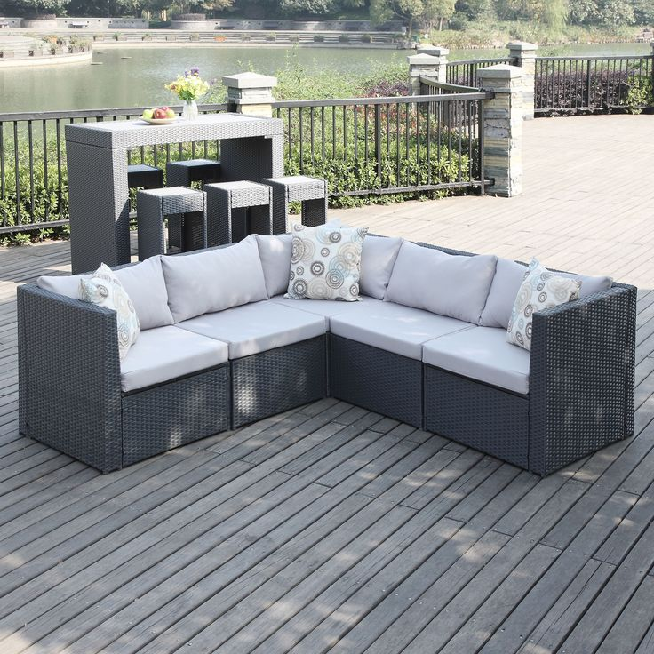 The Portfolio Aldrich 5-piece sectional features 3 corner chairs and 2 armless chairs in grey resin wicker and composite wood. Ideal for small space living, this set can be used for both indoor and outdoor living to create a relaxing seating area.
