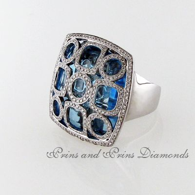 Centre stone is a 45.99ct square cut blue topaz with 1.08ct round brilliant cut diamonds pavé set in a fancy pattern over the centre stone set in 18k white gold