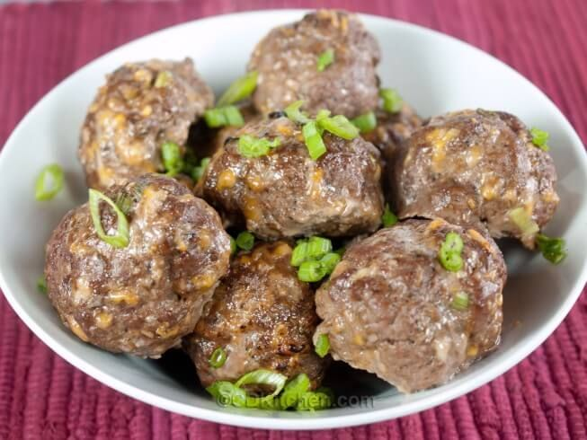 Jazz up boring meatballs! These are made with ground beef that is mixed with fajita seasoning mix, egg, green onion, garlic, and colby jack cheese.