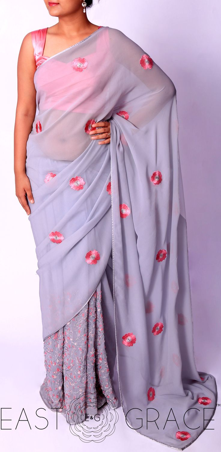 Presenting a light steel blue pure georgette saree with Briar Rose flowers, hand-crafted in silk thread embroidery all over the pallu. The skirt of the saree has climbing cherry blossom floral vines decorated with pink French knots. PRICE: INR 12,444.00; USD 183.00. Please visit: www.eastandgrace.com/products/briar-rose For help reach us at care@eastandgrace.com; With Love www.eastandgrace.com