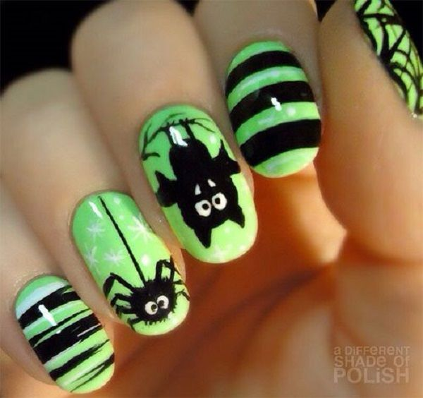 With this manicure you can't mistake for Halloween. Black color and scary motives like bats and spiders are the symbols of Halloween.