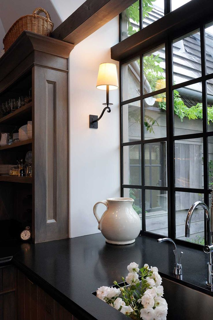 Sometimes it's the little details that make a home, like the black framed windows and warm lighting in this urban kitchen | Urban Electric Co.