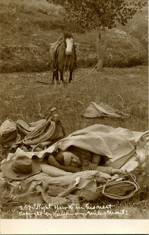 Night Hawk in his nest - By L. A. Huffman - 1890. Image depicts a sleeping man in his bedroll surrounded by his saddle, spurs, revolver, hat, saddle, saddle blanket, etc. and a horse hobbled in the immediate background, with a group of horses in the distant background. (http://www.abebooks.fr/NIGHT-HAWK-NEST-MATTED-FRAMED-ORIGINAL/574186010/bd)