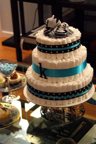Diaper Cake with Baby shoes as topper, luv that!!!