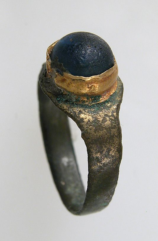 Finger Ring  Date: 7th century Geography: Made in, Northern France Culture: Frankish Medium: Copper alloy, gilding, gold, glass paste cabochon
