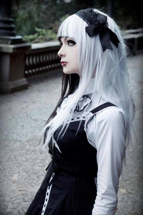 Lovely half and half, black and white hair. So pastel goth. And she is just gorgeous.