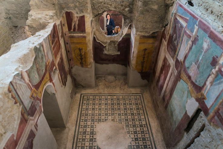 Visitors explore a restored bathhouse in ancient Pompeii