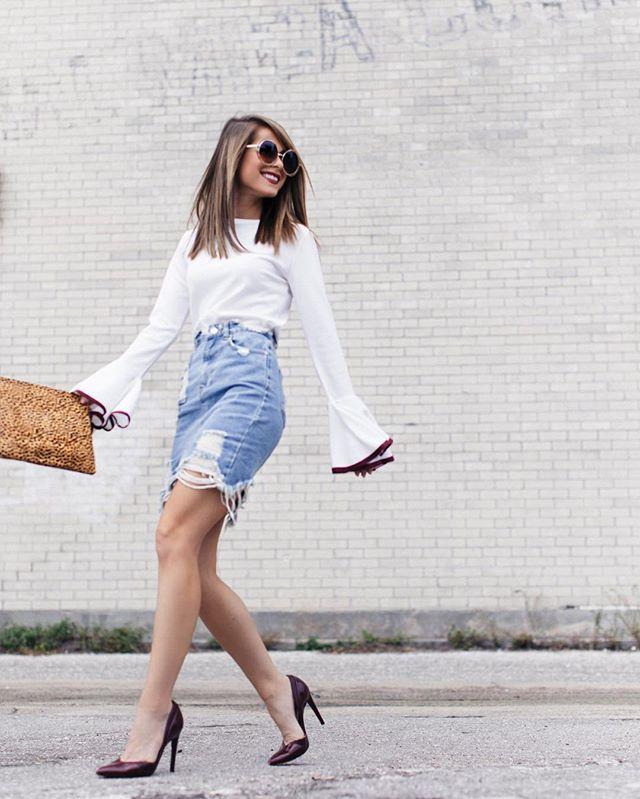 A bell-sleeved top + distressed denim skirt.