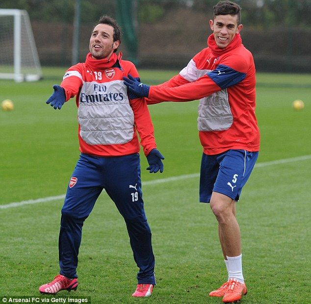 New signing Gabriel Paulista shares a joke with Santi Cazorla at London Colney...