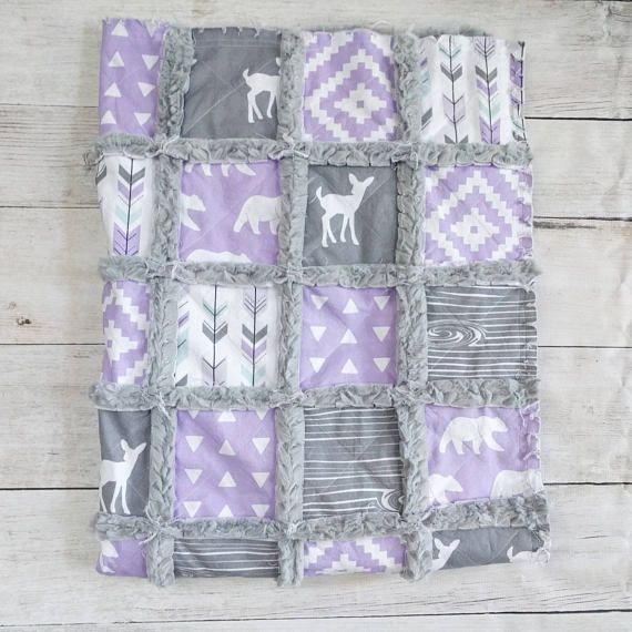 These woodland prints in lilac and gray are so beautiful and are the perfect addition to a baby girls nursery, or even just for a fun stroller blanket! This quilt is done in such pretty, modern colors with beautiful patterns, arrows, and deer prints. The back of this quilt will be done