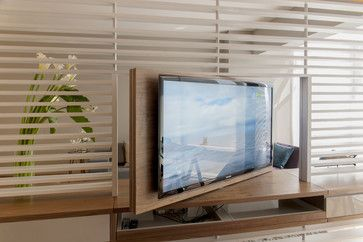 Use a swivel TV mount to conceal it during formal gatherings.— Pacori Interiors: