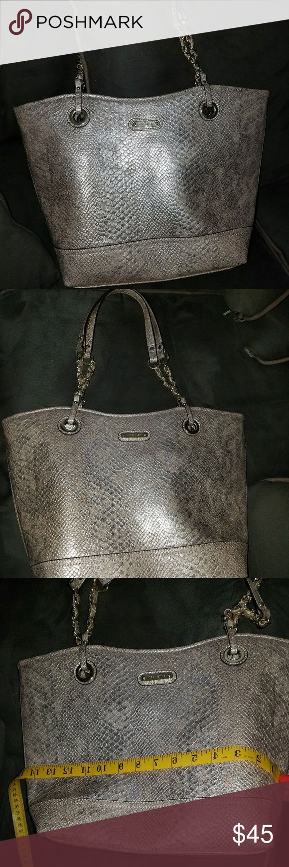 New Anne Klein gold medium tote. No tag, mint cond New Anne Klein Medium Tote. Chain Link handles. Lined with a beautiful floral print. Gift, never used. Mint  condition. Anne Klein Bags Totes